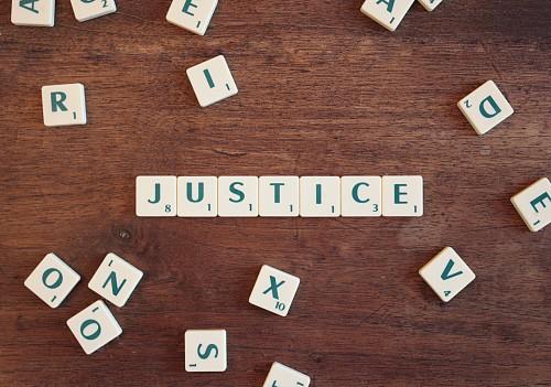 COMMISSAIRE DE JUSTICE : LA FUSION DE DEUX PROFESSIONS